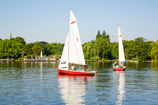 Sailing boats with people