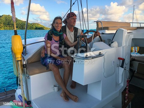 Mature couple sailing the lagoon at Bora Bora. Bora Bora is a major international tourist destination, famous for its aqua-centric luxury resorts. The major settlement, Vaitape, is on the western side of the main island, opposite the main channel into the lagoon.