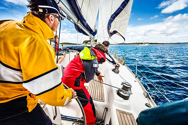 sailing crew beating to windward on sailboat - sail stock pictures, royalty-free photos & images