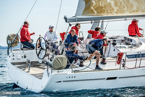 Sailing crew on sailboat on regatta in action. Models and event regatta property released.