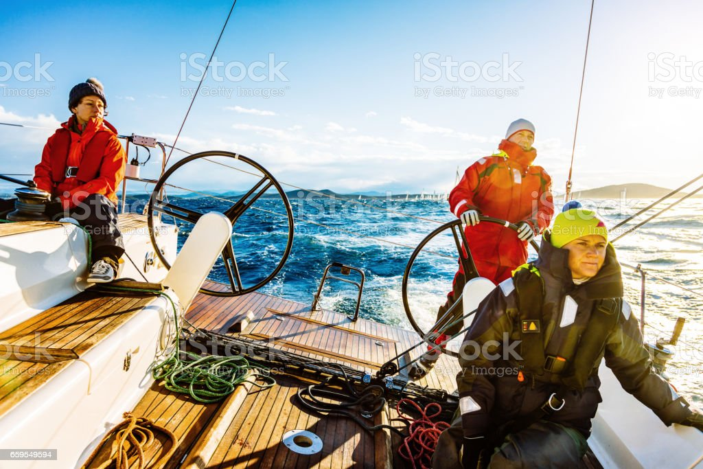 Sailing crew on sailboat on regatta stock photo