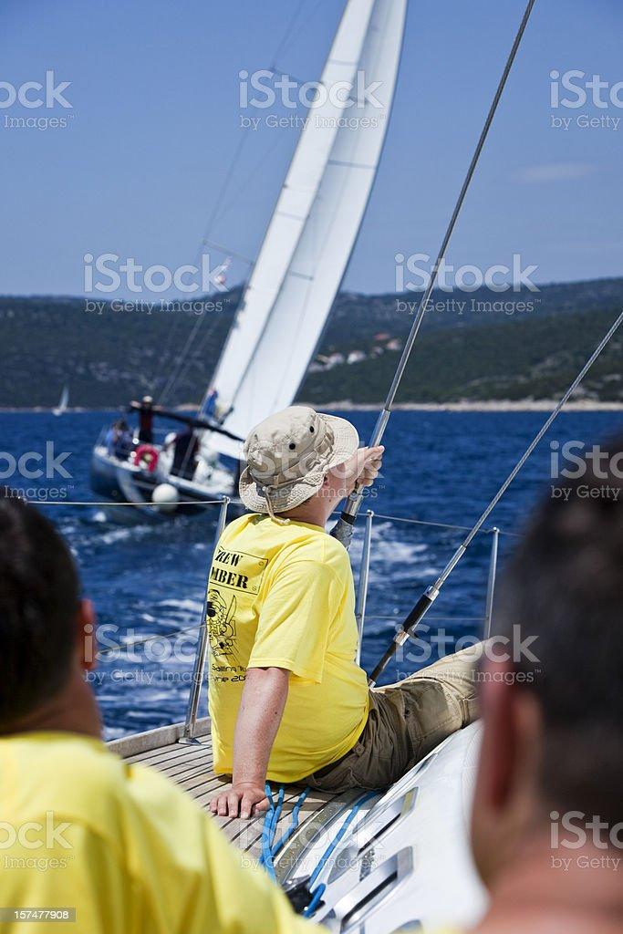 Sailing crew on sailboat royalty-free stock photo
