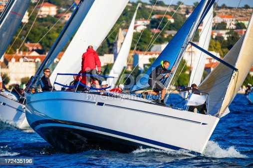 1011210354istockphoto Sailing crew on sailboat 172435196