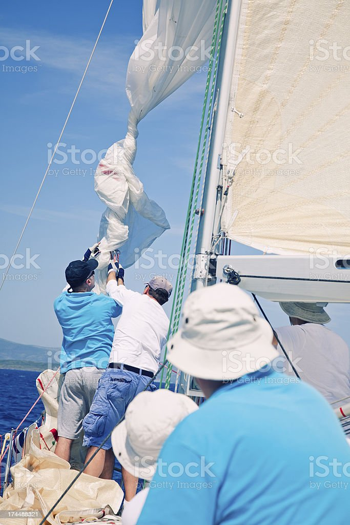 Sailing crew on sailboat royalty-free stock photo