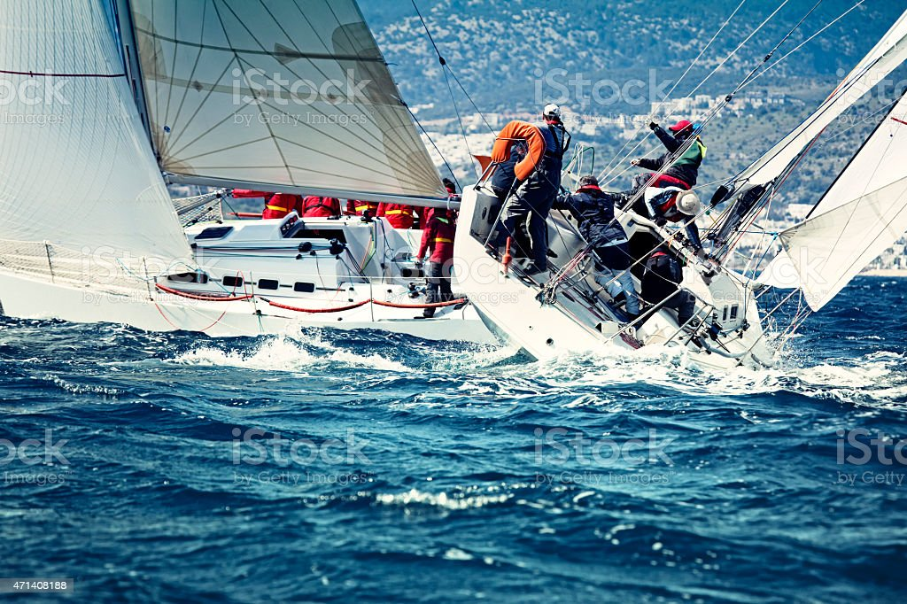 Sailing crew on sailboat stock photo