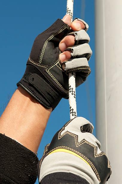 sailing detail with rope and glove - segelhandschuhe stock-fotos und bilder