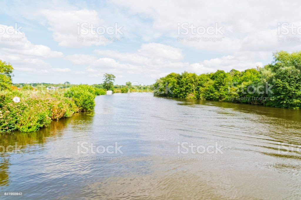 Sailing down the River Bure, in Norfolk, on a summer day. stock photo