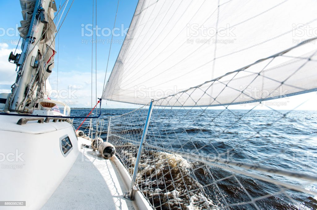 Sailing fast on port tacks with water splashing on deck stock photo