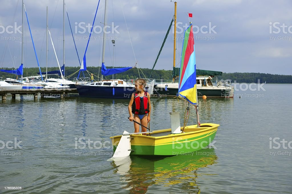 Sailing, Girl flows in a sailboat on the lake royalty-free stock photo