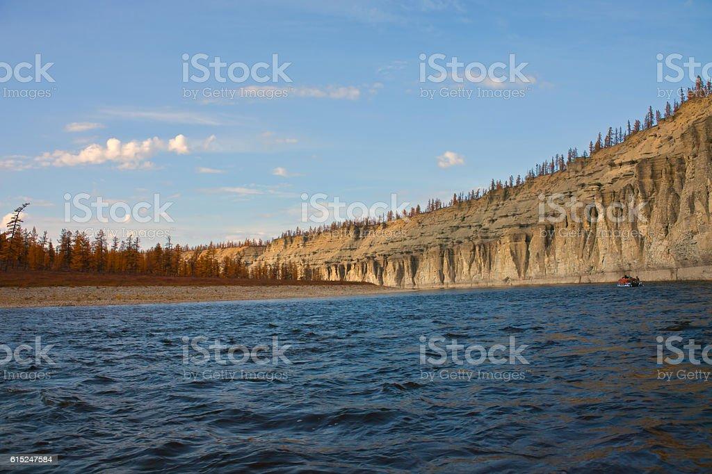 Sailing in  boat in the Siberian taiga river stock photo
