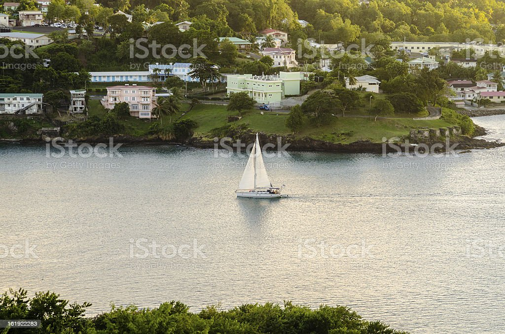 sailing in serene waters and residential coast royalty-free stock photo