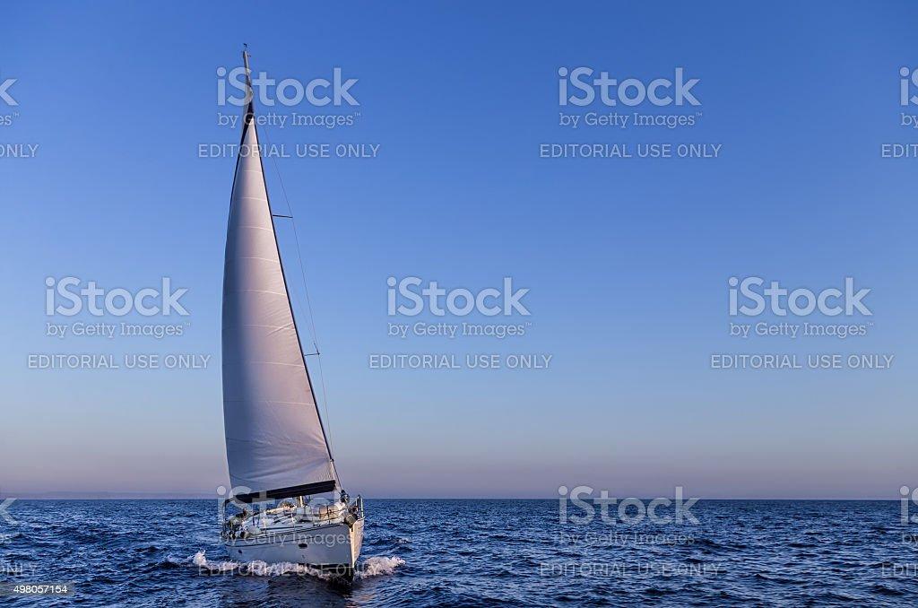 Sailing in the dusk in the Aegean sea, Greece Saronic Gulf, Greece - July 24, 2015: Sailing in the dusk in the Aegean sea, Greece 2015 Stock Photo