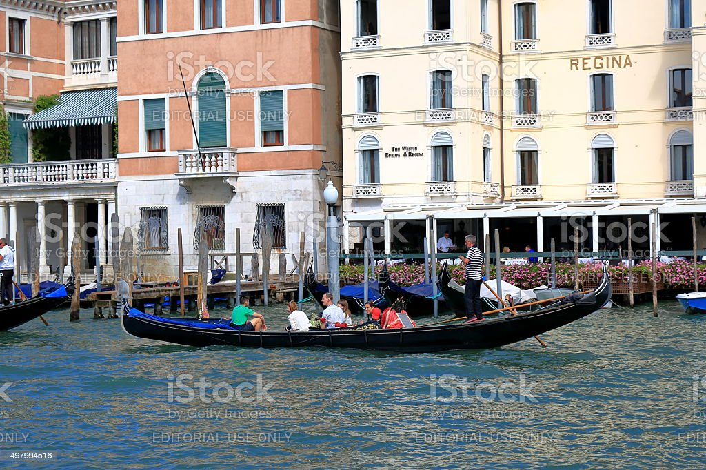 Sailing in the gondola people by Grand Canal in Venice stock photo