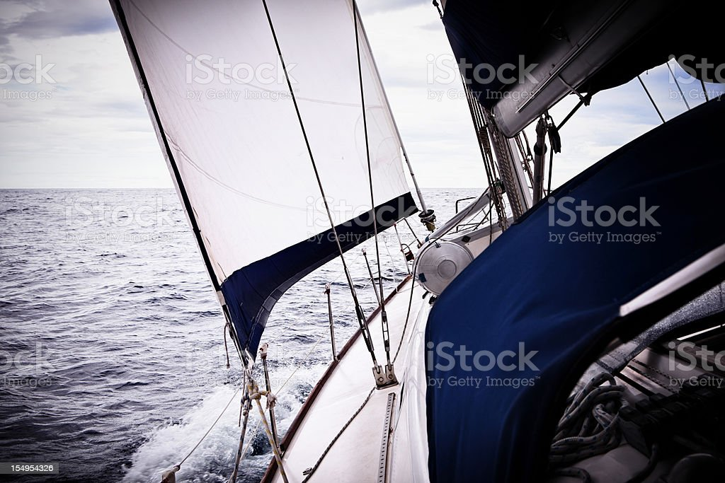 Sailing in the wind with sailboat royalty-free stock photo