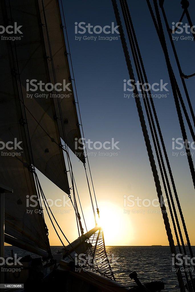 Sailing into Sunset stock photo