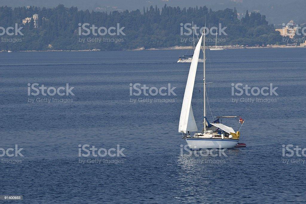 Sailing on blue royalty-free stock photo