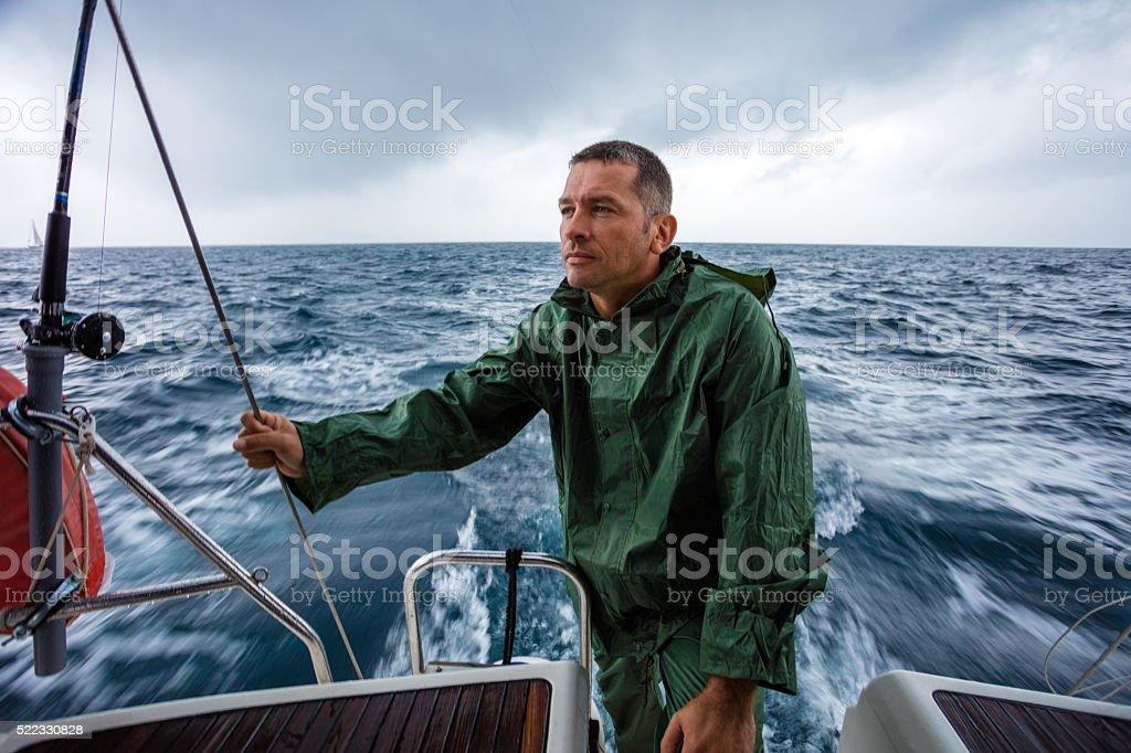 Sailing on sailboat yacht stock photo