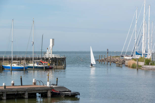 Sailing out of the old harbour of Hindeloopen, The Netherlands stock photo