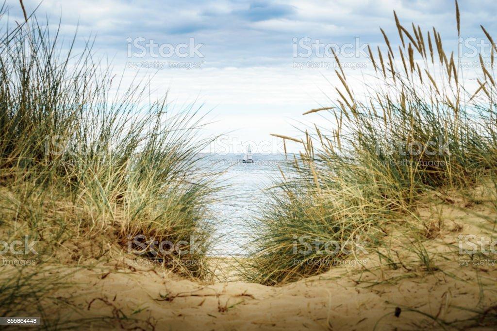 Sailing past the dunes stock photo