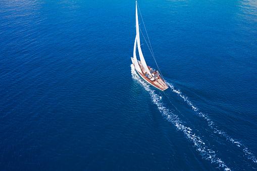 Classic sail boat in Mediterranean sea, aerial view