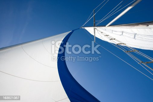 Wind fills sails on a clear day.