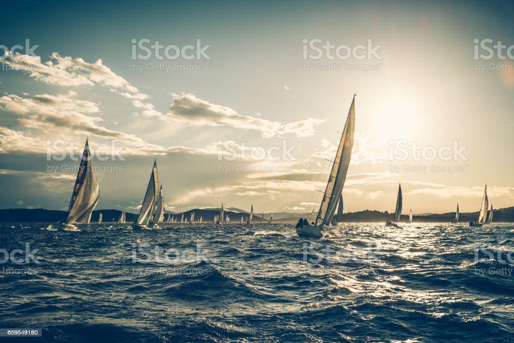 Sailing regatta on sunny autumn morning stock photo