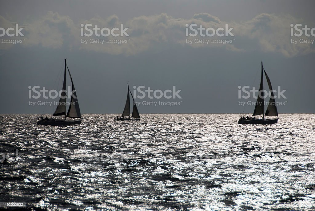 Sailing sailboats on the sea in winter stock photo