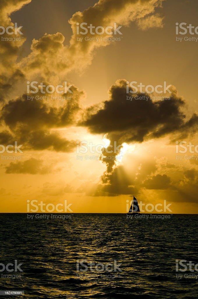 Sailing sea ship at golden sunset royalty-free stock photo