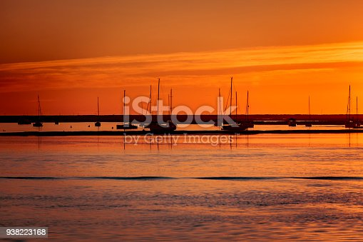ships resting at sunset in the harbor of faro in portugal.