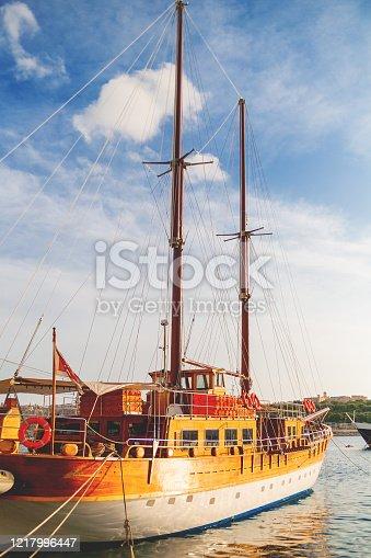 Sailing ship moored on sea embankment, Sliema, Malta.