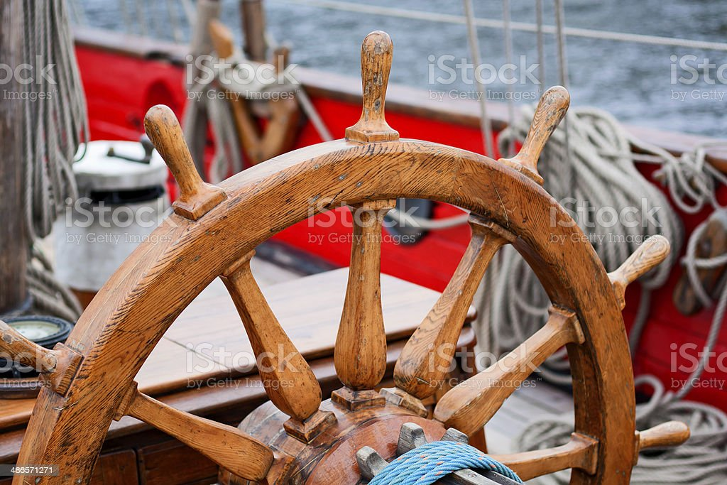 Sailing ship old wooden steering wheel stock photo