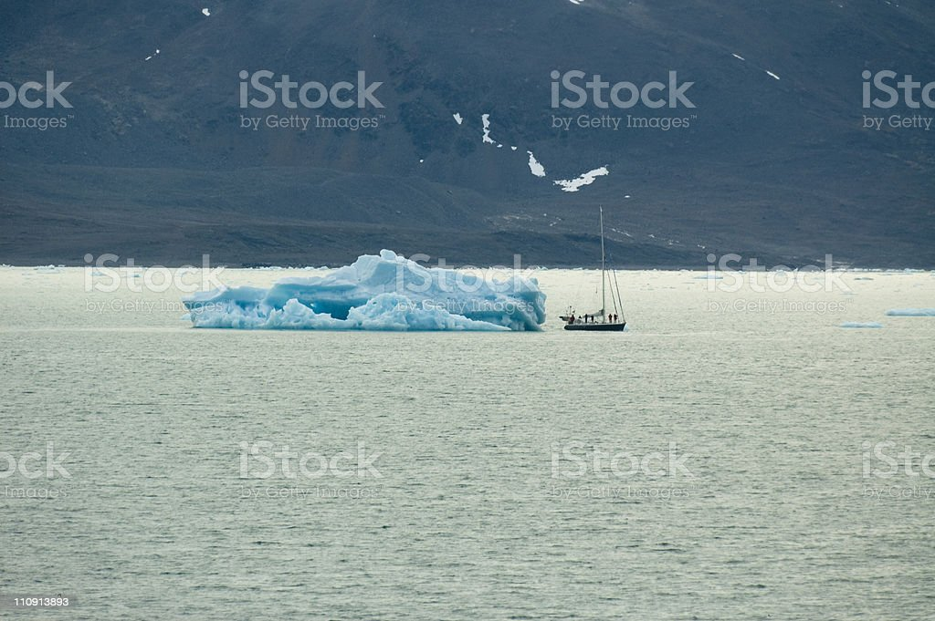 Sailing ship with iceberg royalty-free stock photo