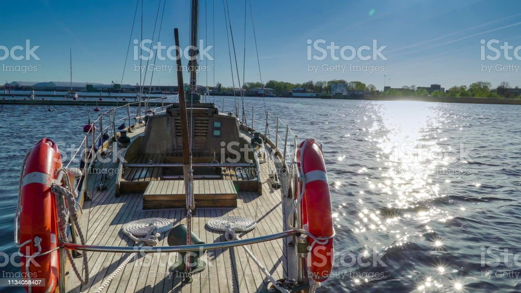 A sailing ship with the orange ring bouy on the side stock photo