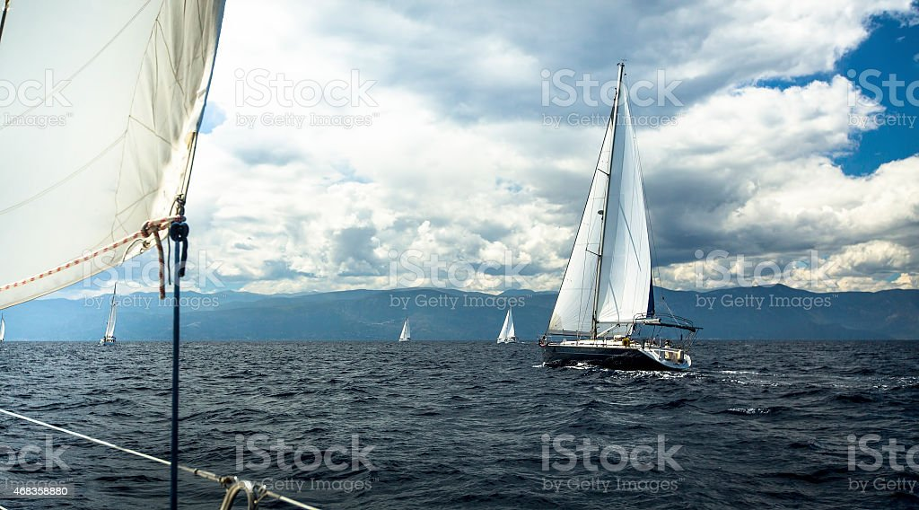 Sailing ship yachts with white sails in stormy weather. royalty-free stock photo