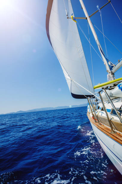 Sailing. Ship yachts with white sails in the open Sea stock photo