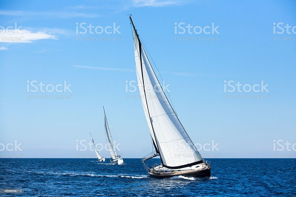 Sailing ship yachts with white sails. Luxury yachts. stock photo