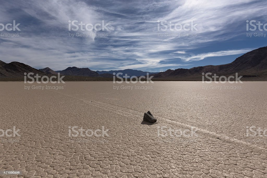 Sailing Stone on a cracked dry lake floor stock photo