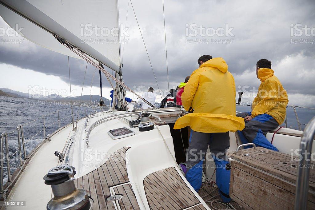 Sailing team on yacht stock photo