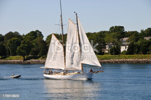 A sleek ketch cruises the waters of the Cape Cod Canal on a beautiful summer afternoon.