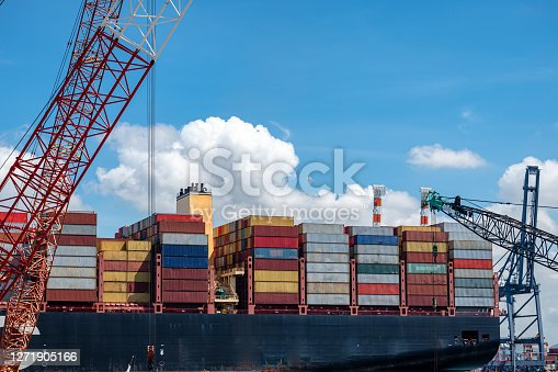 Aft stern of the largest container ship in accomodation bay storage of containers units on sailing time, leaving departure of the container ship from the port to next port destibation