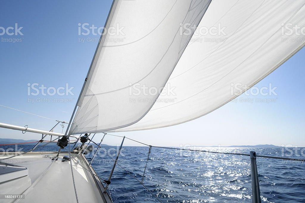 Sailing towards the horizon on a sunny day royalty-free stock photo