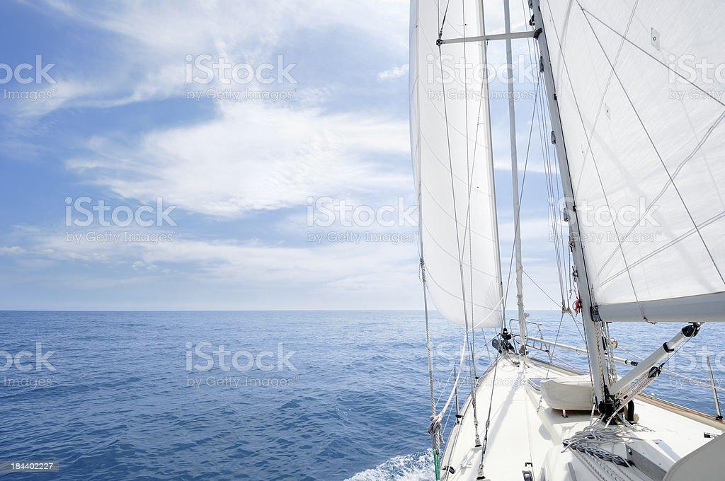Sailing towards the horizon on a sunny day stock photo