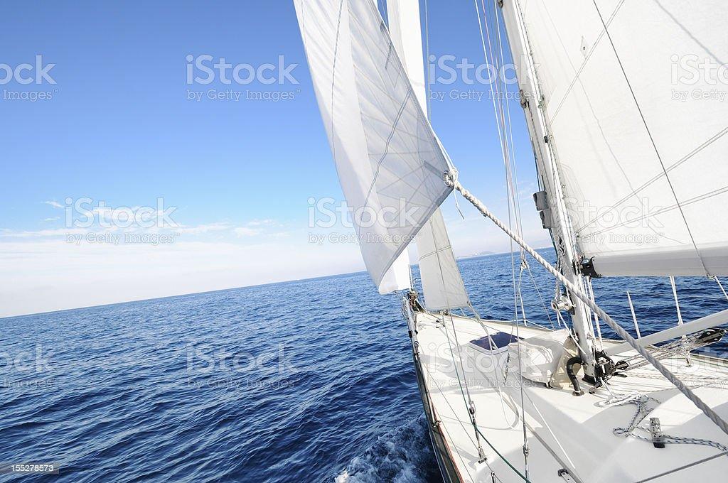 Sailing towards the horizon royalty-free stock photo