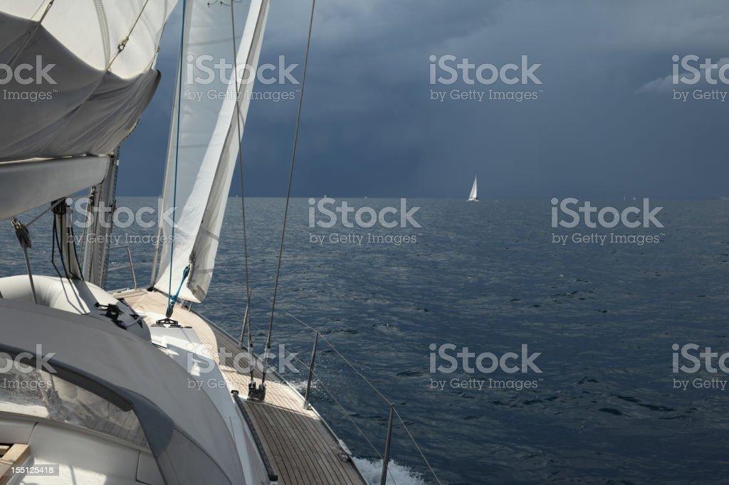 Sailing under storm royalty-free stock photo