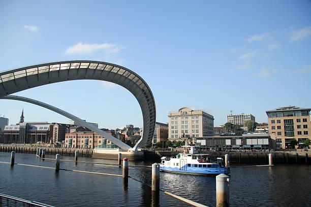 sailing under the millenium bridge - gateshead stock photos and pictures