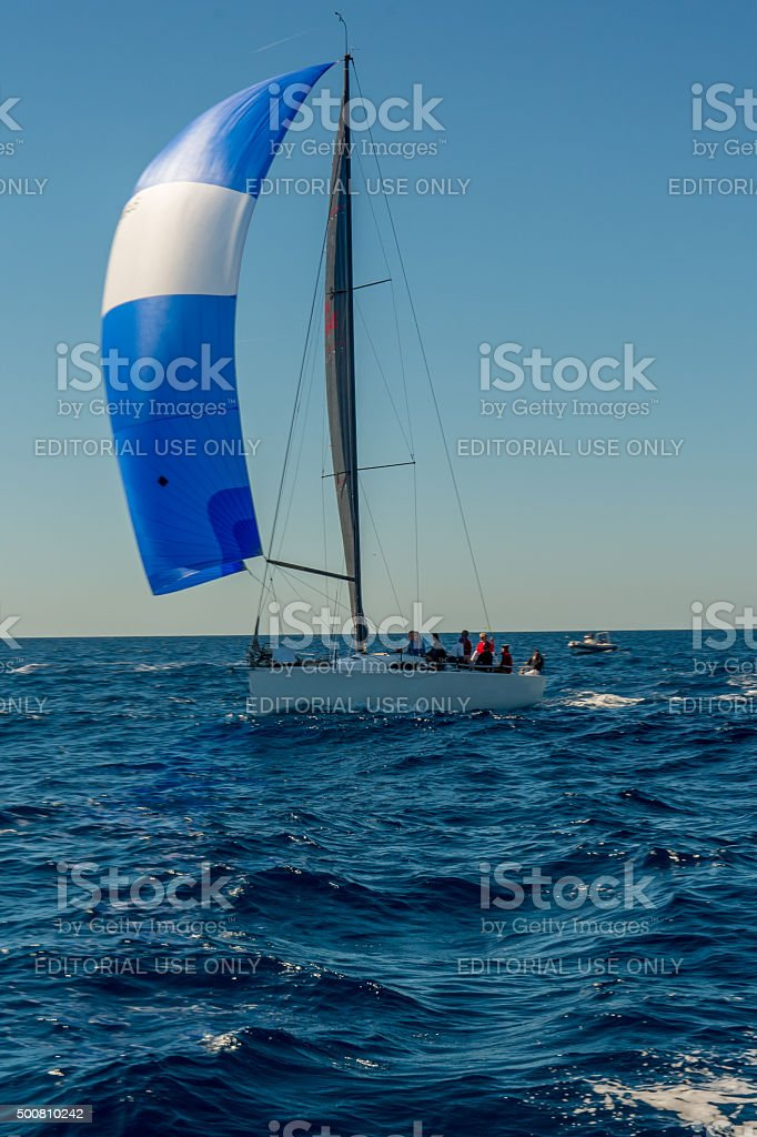 sailing with blue spinnaker. stock photo