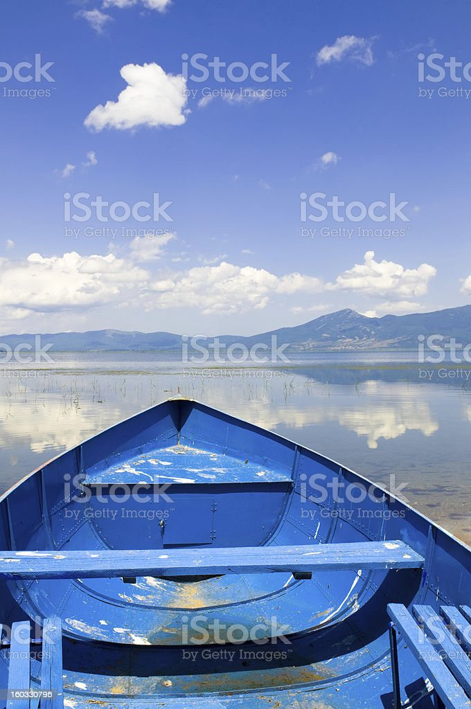 Sailing with Old Fishing Boat on Beautiful Mountain Lake royalty-free stock photo