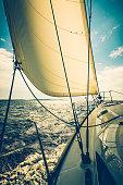 Sailing with sailboat at sunset, Dalmatia, Croatia.