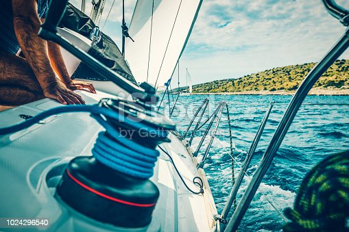 Sailing with sailboat at Kornati islands, Croatia..
