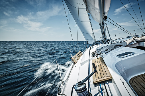 Sailing with sailboat. Long exposure.